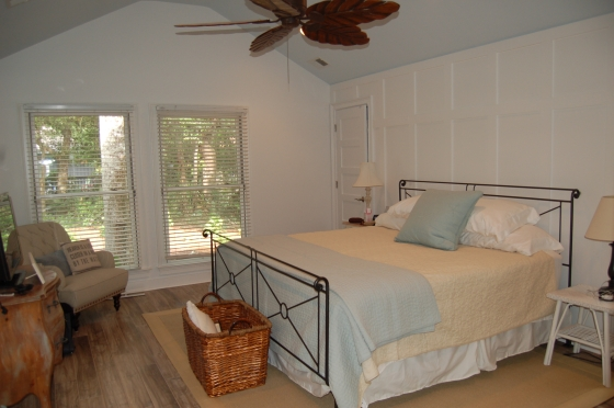 Master Bedroom with new floor, board and batten wall treatment.  Love the light blue ceiling.